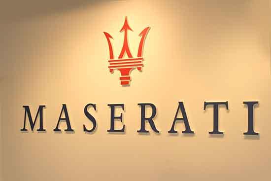Maserati dealership identity, company showroom and sign.
